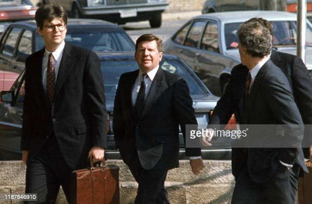 Businessman Richard Secord is escorted to the US District Court 24 March Washington DC where he pleaded not guilty to charges of conspiring to...