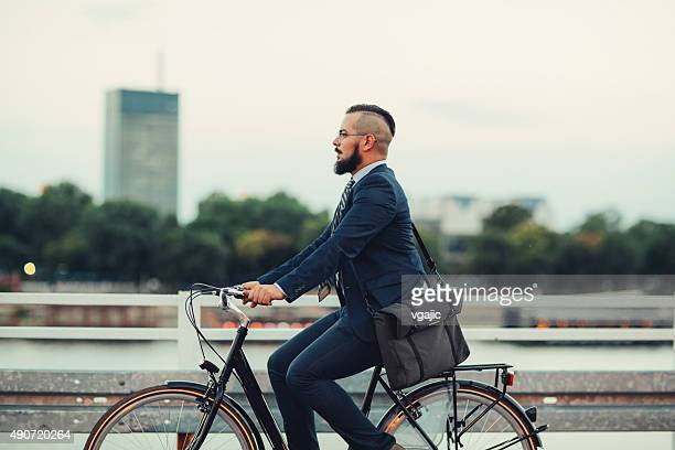 Businessman Ride Bicycle From Work Late.