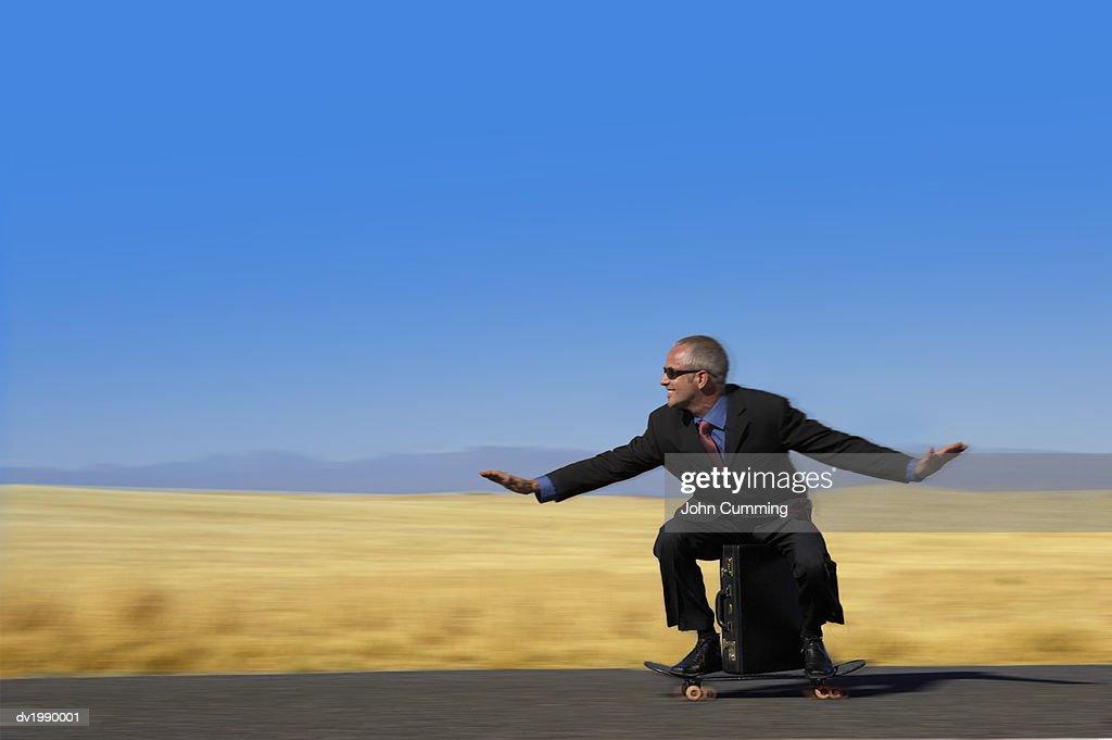 Businessman Riding a Skateboard : Stock Photo