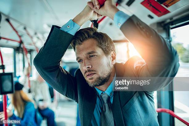 Businessman riding in a bus
