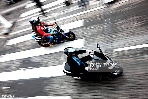 Businessman riding moped, blurred motion