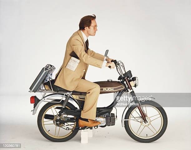 Businessman riding motorbike on white background