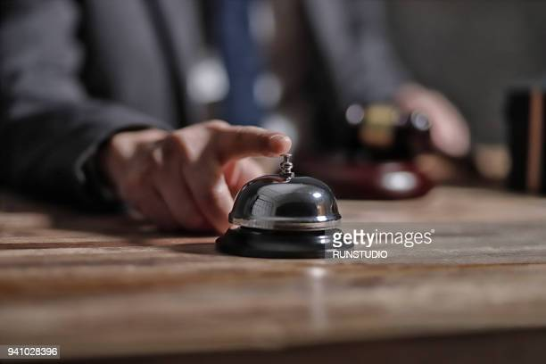 Businessman ringing service bell