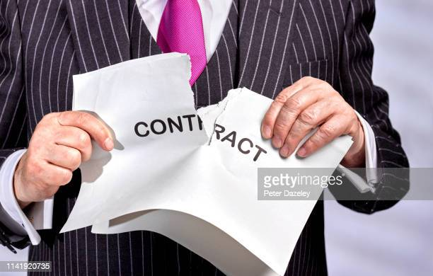 businessman ripping up contract - agreement stock pictures, royalty-free photos & images