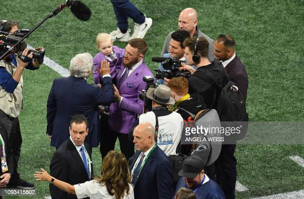 Businessman Robert Kraft greets Conor McGregor, Irish mixed martial artist, prior to the start of Super Bowl LIII between the New England Patriots...