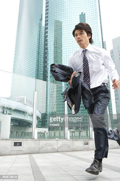 Businessman running in city