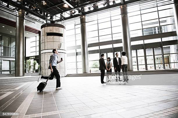 Businessman Running, Multi Ethnic Group Looking, Kyoto, Japan