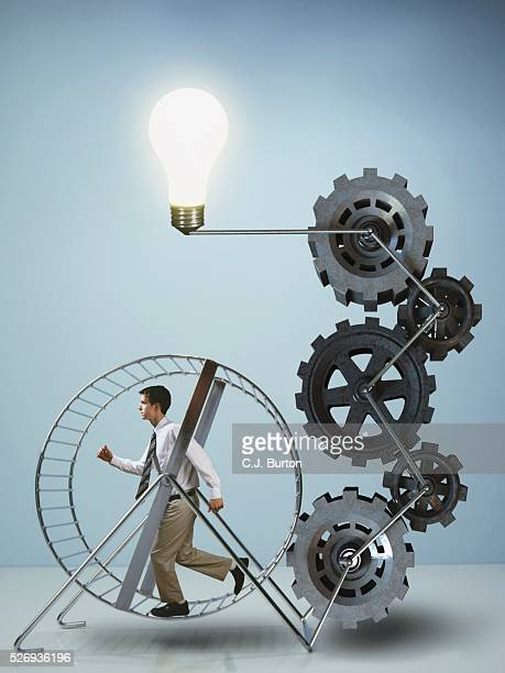 Businessman running on exercise wheel