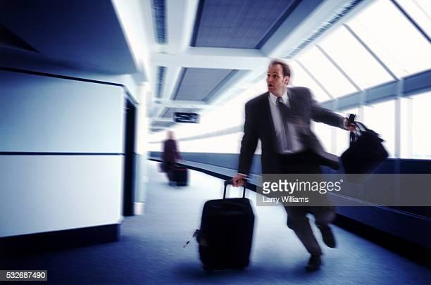 Businessman Running to Catch a Flight
