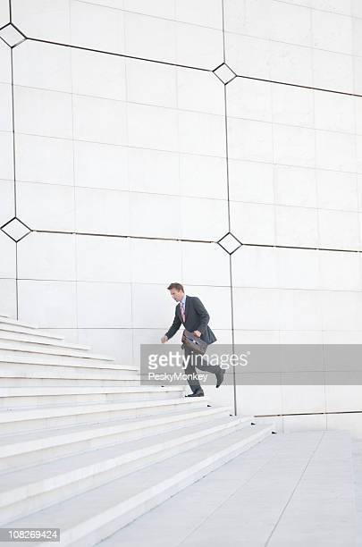 Businessman Running up Staircase