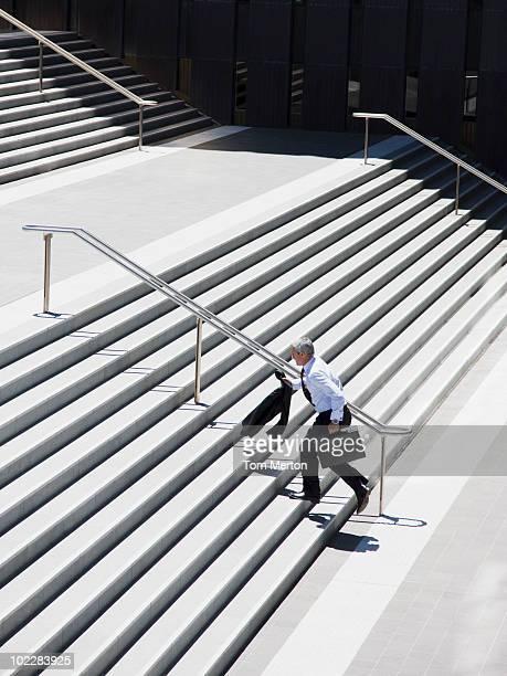 Businessman running up stairs