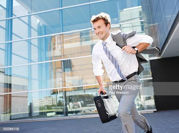 Businessman running with briefcase