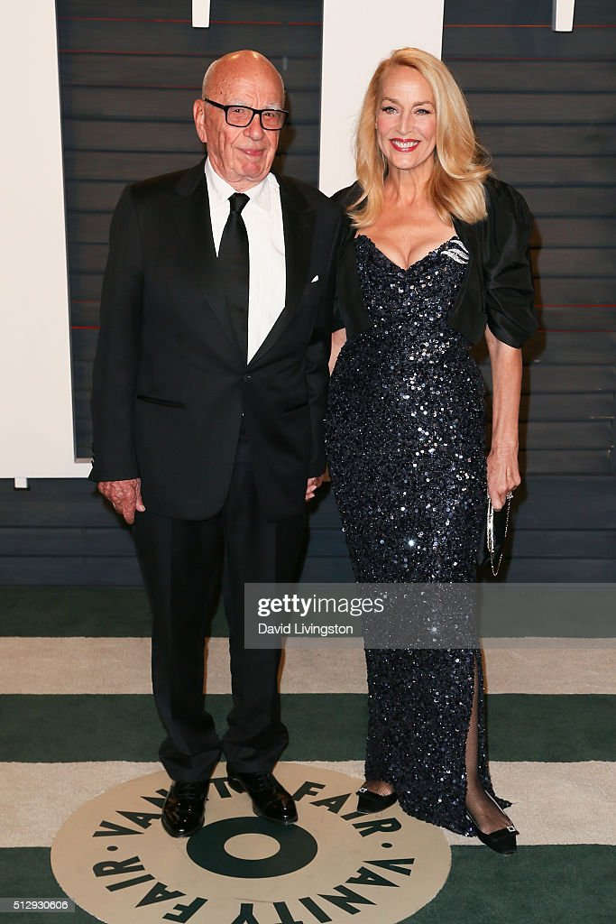 Businessman Rupert Murdoch (L) and actress Jerry Hall arrive at the 2016 Vanity Fair Oscar Party Hosted by Graydon Carter at the Wallis Annenberg Center for the Performing Arts on February 28, 2016 in Beverly Hills, California.
