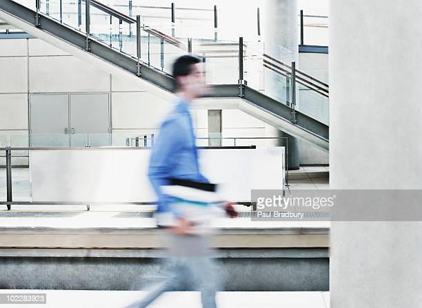 Businessman rushing on train platform