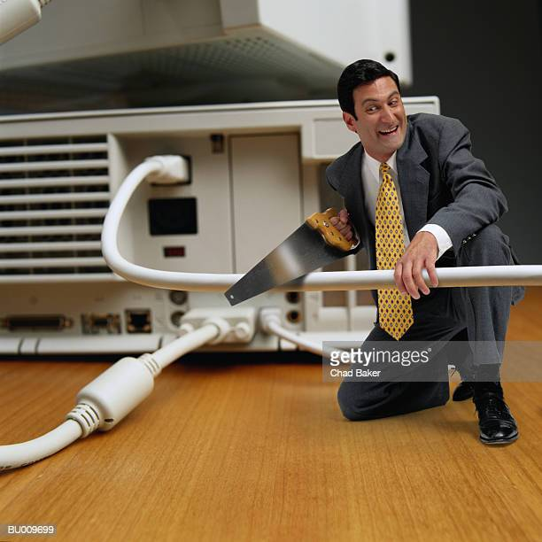 Businessman Sawing Computer Cable