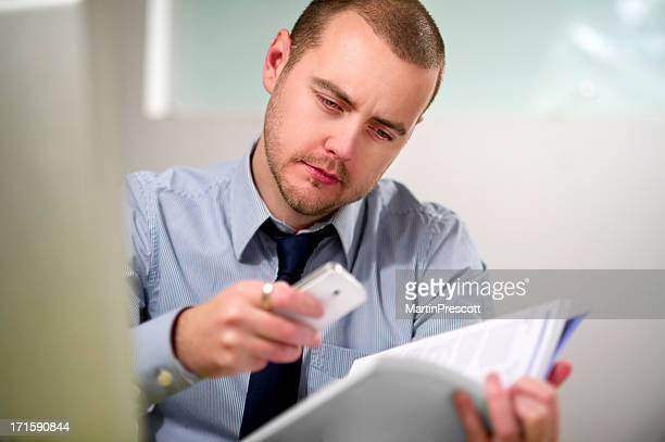 businessman scanning qr code