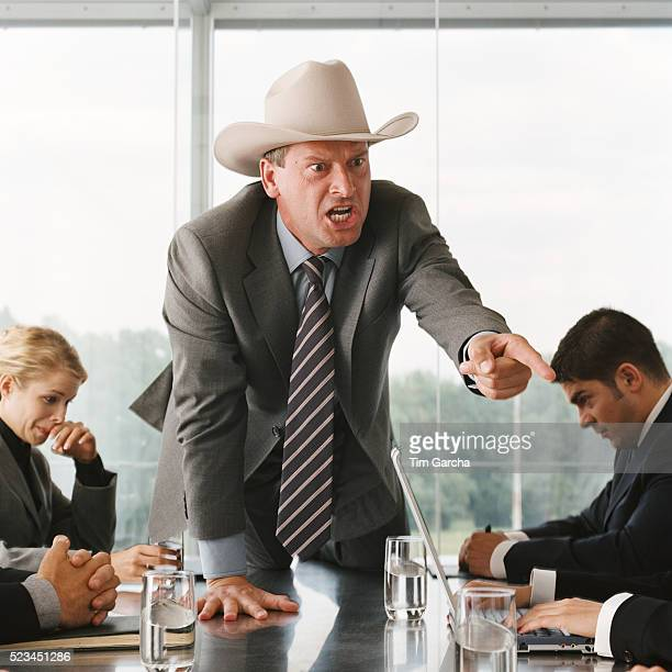 Businessman Scolding Employees During Meeting
