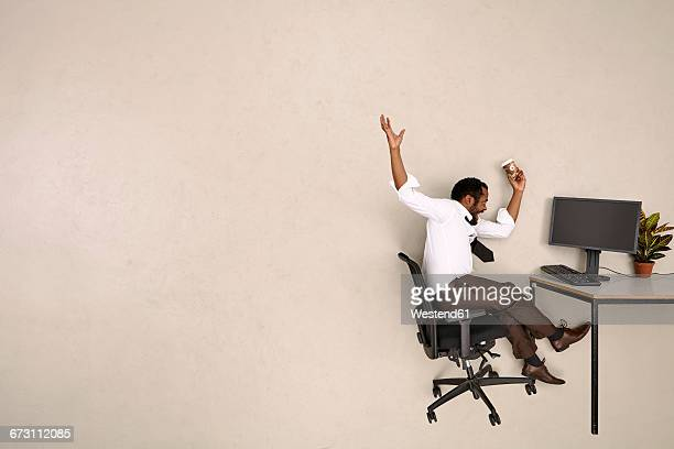 Businessman screaming at his computer