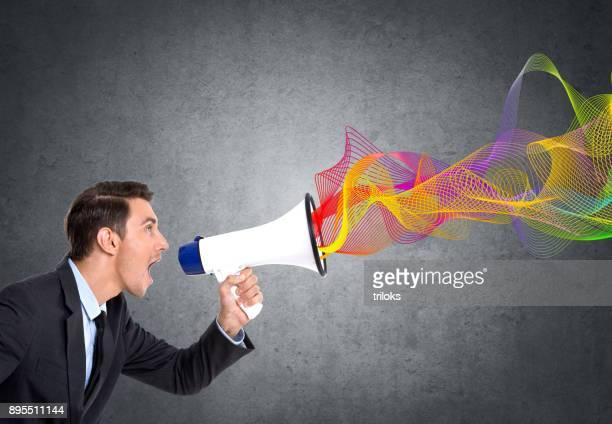 Businessman screaming on megaphone