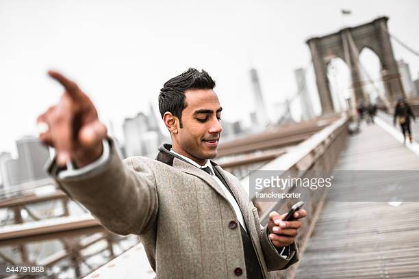 Businessman searching on the brooklyn bridge