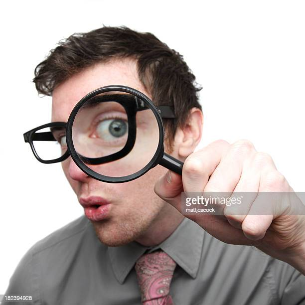 Businessman searching with magnifying glass