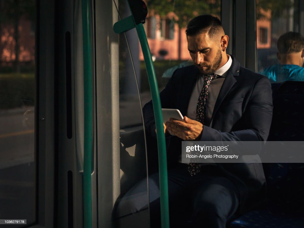 businessman seat in a tramway and looking his tablet : Photo