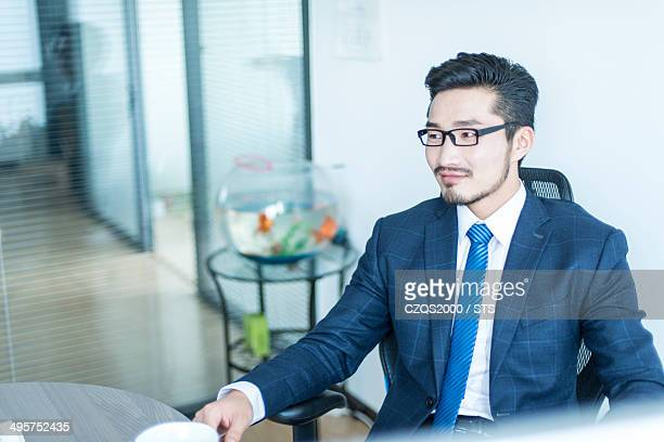 businessman seated in office