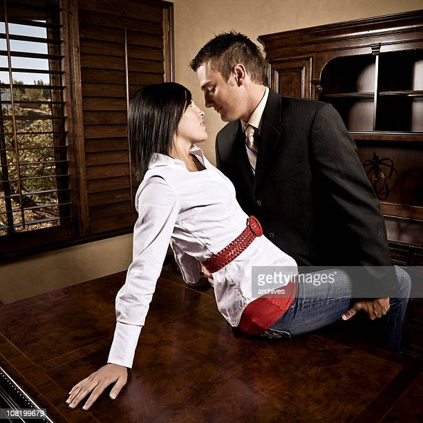 Businessman Seducing Secretary in Office