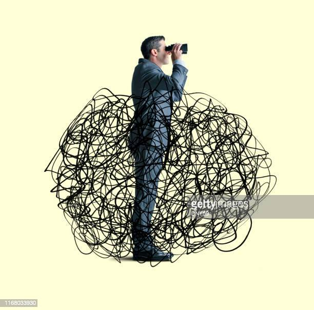 businessman seeking clarity - mixed media stock pictures, royalty-free photos & images