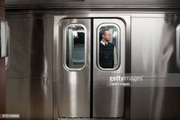 businessman seen through train door - subway stock pictures, royalty-free photos & images