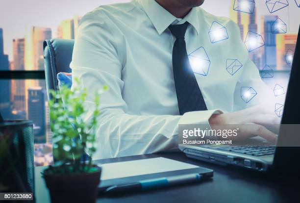 businessman  sending e-mails from your computer concept - marketing icons stock photos and pictures