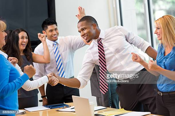 Businessman shaking hands after closing deal in meeting