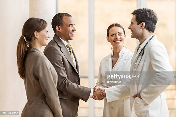 Businessman shaking hands with a doctor.