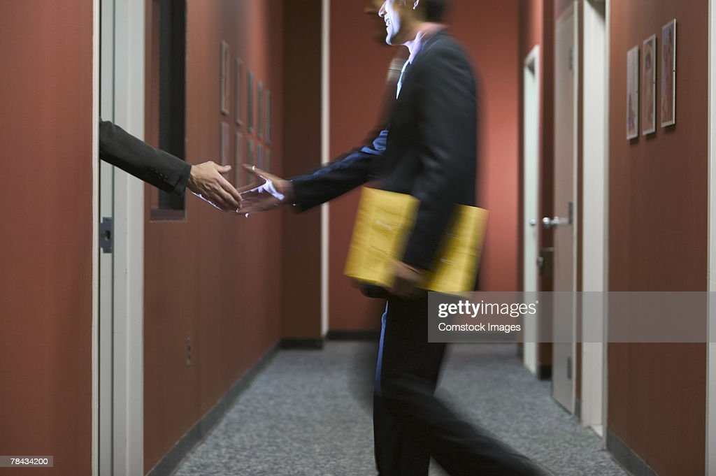 Businessman shaking hands with person : Stockfoto