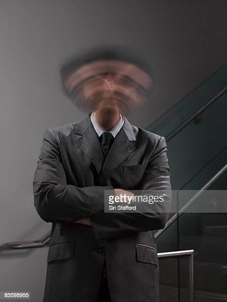 Businessman shaking head, blurred motion