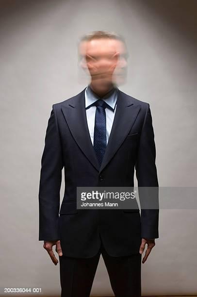 Businessman shaking head (long exposure)