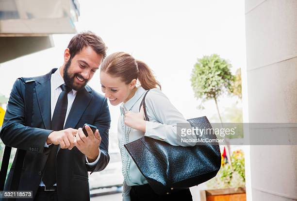 Businessman shares stock market results with colleague on mobile phone