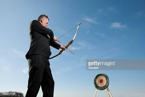 Businessman shooting on target