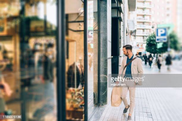 businessman shopping in valencia - boutique stock pictures, royalty-free photos & images