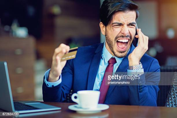 Businessman shopping online is reporting about a problem with his credit card