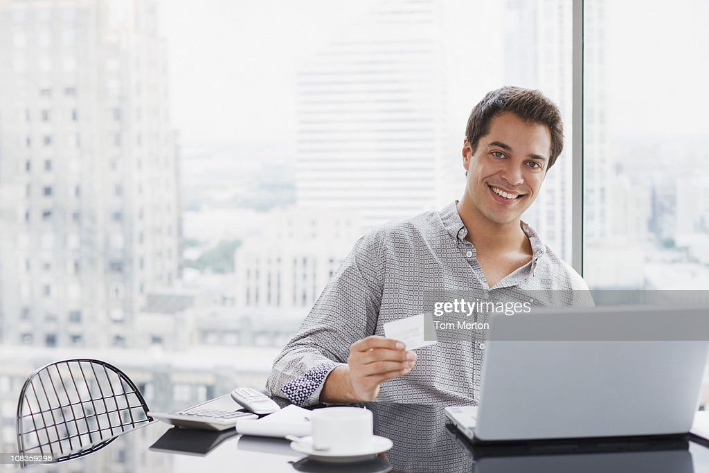 Businessman shopping online with credit card : Stock Photo