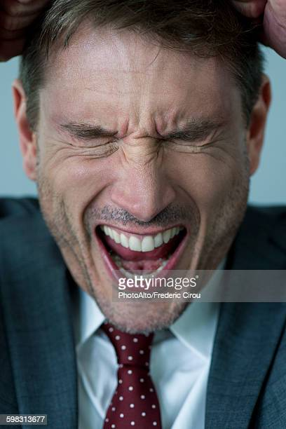 Businessman shouting in frustration