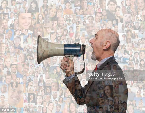 Businessman shouting in megaphone over montage of smiling faces