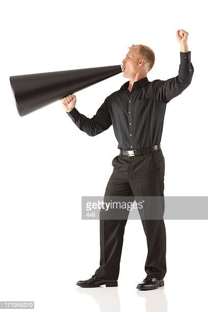 businessman shouting into a bullhorn - black trousers stock pictures, royalty-free photos & images