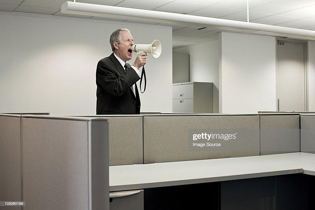 Businessman shouting through megaphone : Stock Photo
