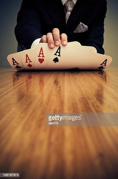 Businessman Showing Card Hand of Aces