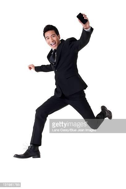 Businessman showing cellphone