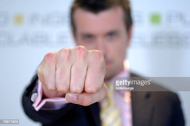 businessman showing his fist