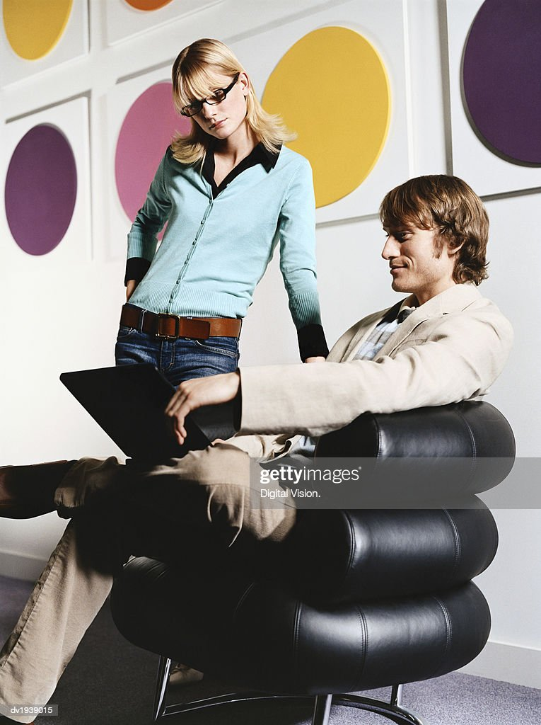 Businessman Showing His Laptop to a Businesswoman : Stock Photo