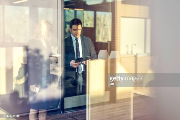 Businessman showing his partner something on a digital tablet